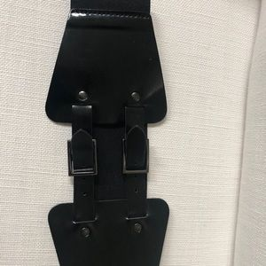 Leather and elastic black two buckle wide belt.